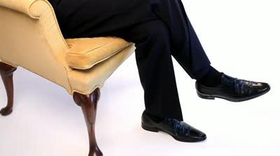 stock-footage-legs-of-a-man-sitting-crossed-legged